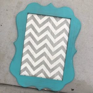 Turquoise frame with magnet background.